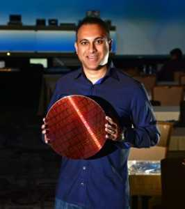 Navin Shenoy displays a wafer containing Intel Xeon processors, April 1, 2019